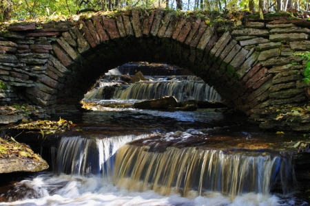 Old stone bridge over a small river  photo