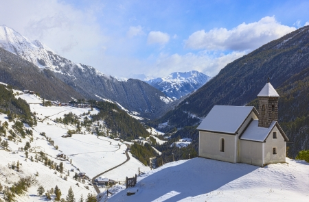 Chapel on the hill in alp landscape photo