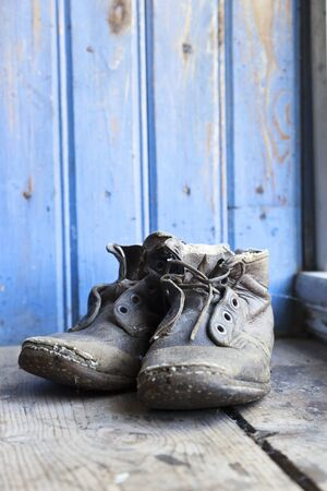Old worn boots on the floor Stock Photo - 15320670