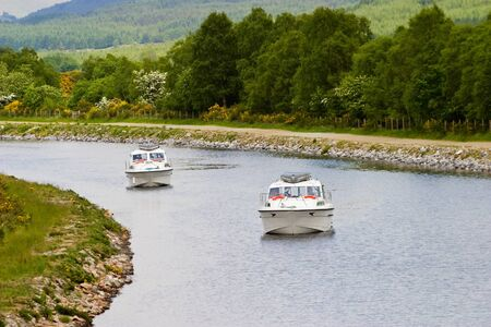 Motorboats at Caledonian canal photo