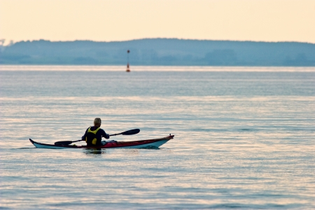 Sea Kayaking at sunset photo