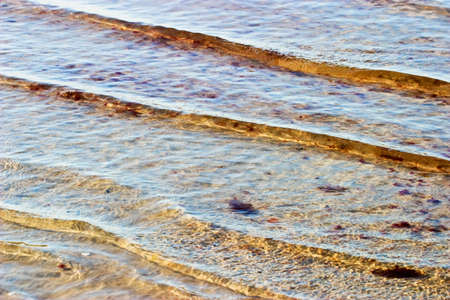 a bathing place: waves pattern at the beach Stock Photo