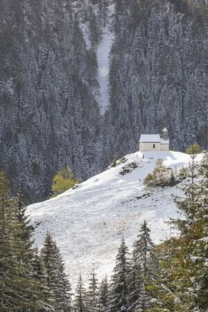 osttirol: Chapel on the hill of mountain forest