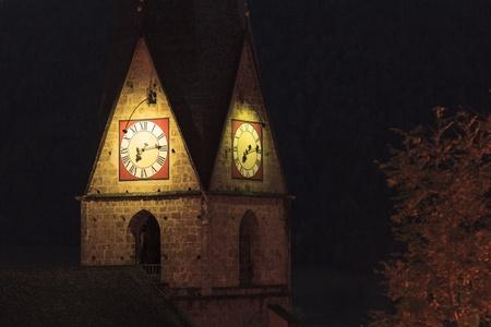 matrei: Illuminated church tower at night