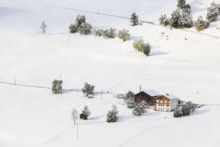 osttirol: Alp farm with newly fallen snow on the field Stock Photo