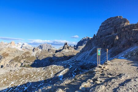 steep cliffs sign: Information sign in Drei Zinnen Nature Park in Italy dolomites Stock Photo