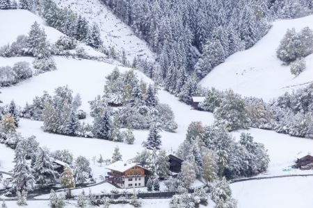 osttirol: Farm in the Alps with newly fallen snow in autumn