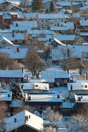 Residential area in winter with snow in the gardens photo