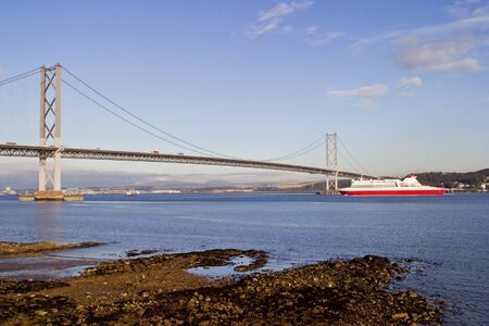 Ferry under the Forth Bridge at South Queensferry Scotland photo