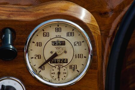 Speedometer in a wooden dashboard Stock Photo - 16555640