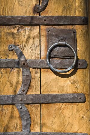 Wooden door adorned with wrought iron photo