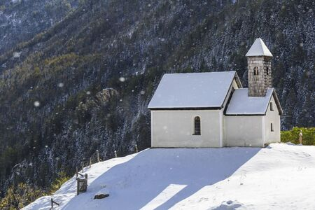chappel: Chapel on the hill in snowfall Stock Photo