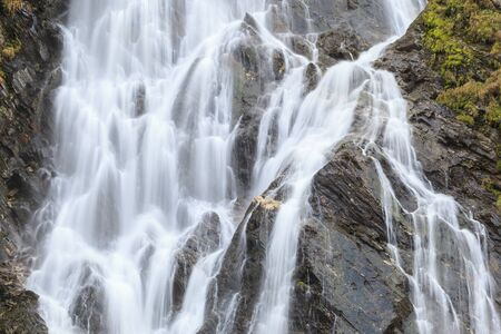 Flowing Waterfall on a cliff photo