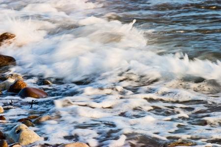 Beach waves on a rocky coast photo