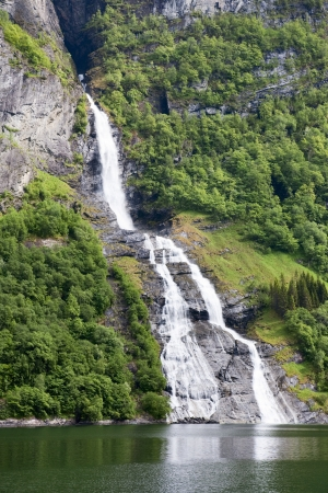 Waterfall flowing from the mountain photo