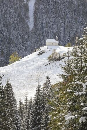 Chapel on the hill of mountain forest photo