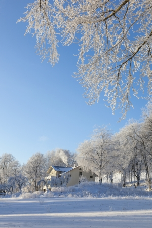 Old house in winter landscape photo