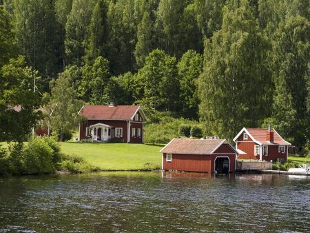 Old Swedish summer cottage at a lake Stock Photo - 17403297