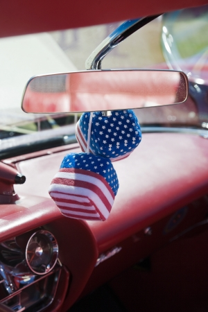 Car dice with american flag photo