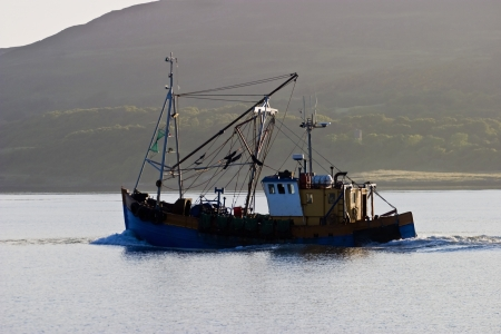 Fishing boat in the bay at down photo