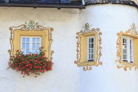 osttirol: Window with window boxes and painted decoration Stock Photo