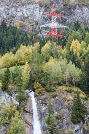 Power line and waterfall in autumn forest photo