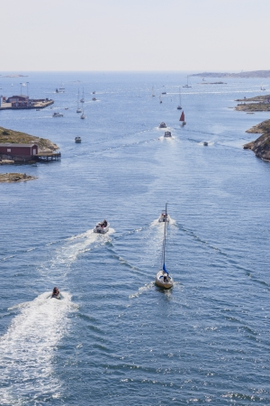 sailingboat: Boats in the channel on the way out to sea Stock Photo
