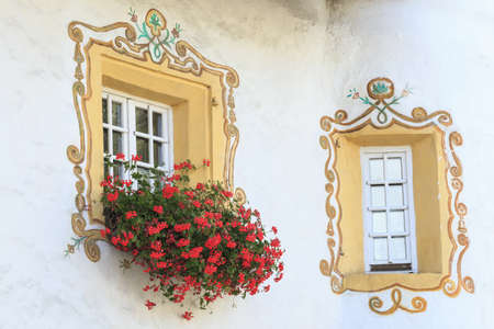 Window with painted decoration and flowers photo