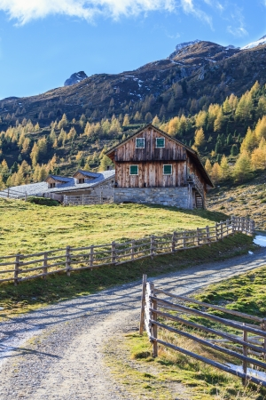 Old weathered alp farm at the mountain photo