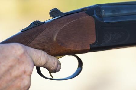 Finger on the trigger of a shotgun