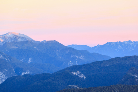Mountain peaks in alpenglow in alps photo