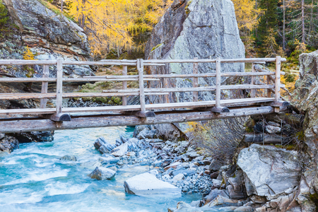 Footbridge over a river photo