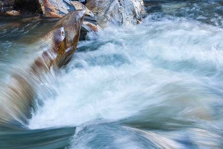 flowing water: Flowing water in a rapid river Stock Photo