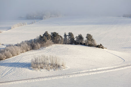 Country road through a wintry landscape photo