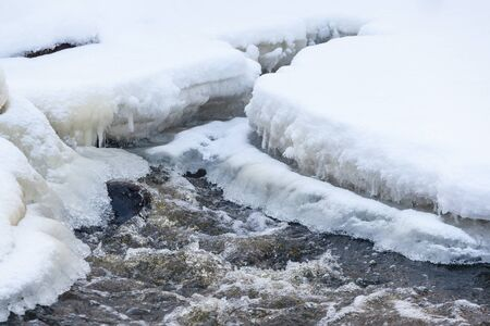 Ice and snow on a frozen river Stock Photo - 24379684