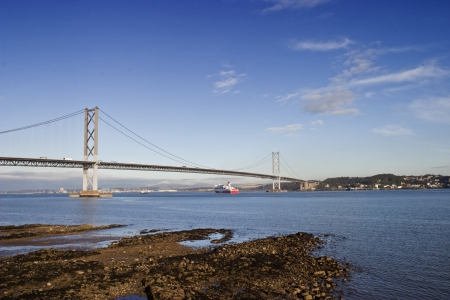 Ferry under the Forth Bridge at South Queensferry Scotland