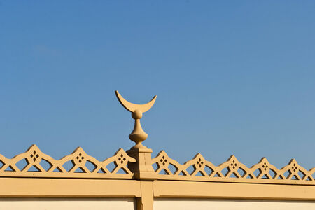 crescent moon: Wood decorations with a crescent Moon on a house roof