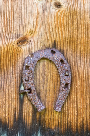 Old horseshoe nailed to a wall photo
