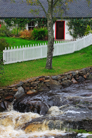 old cottage at the waterfall  photo