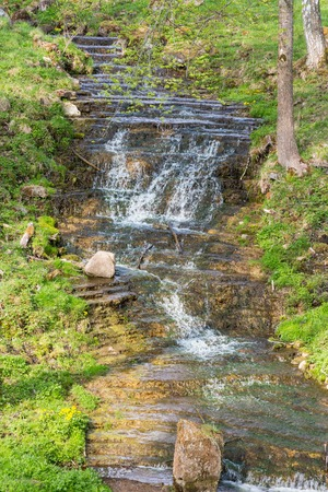 Waterfall in a small ravine photo