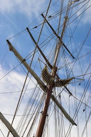 shrouds: Old wooden mast at a tall ship Stock Photo