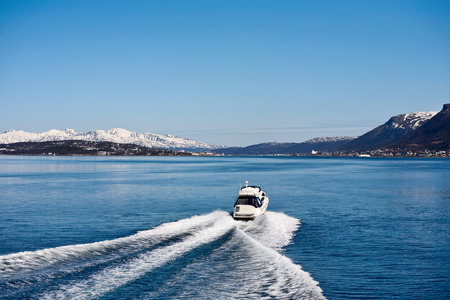 ridge of wave: Motor boat at in sea landscape at spring Stock Photo