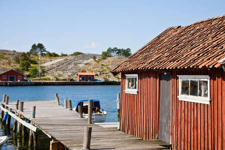 boathouse: Boathouse on the pier Stock Photo