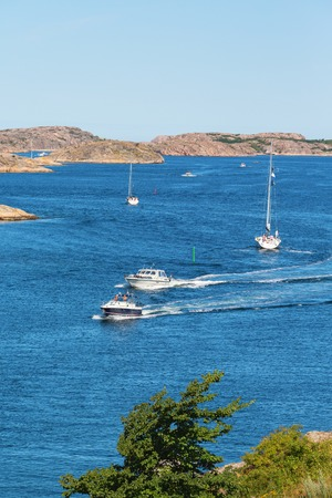 Motorboats and sailboats at sea in the archipelago photo