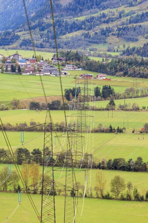 matrei: Power line that goes across the fields in tyrol Stock Photo