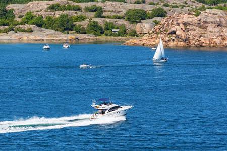 sailingboat: Rocky archipelago with boats on the sea