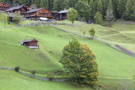 glanz: Old farm in the alp in autumn Editorial