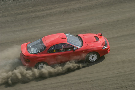 red sports car: Rally car on a racing track