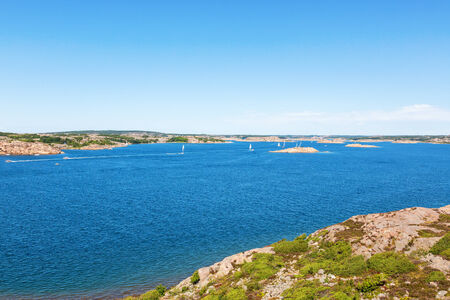 sailingboat: View of the rocky coast archipelago with boats at sea