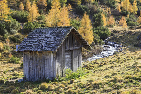 osttirol: Old shed by the creek Stock Photo